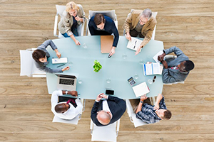 Aerial photo of business people sitting around a conference table