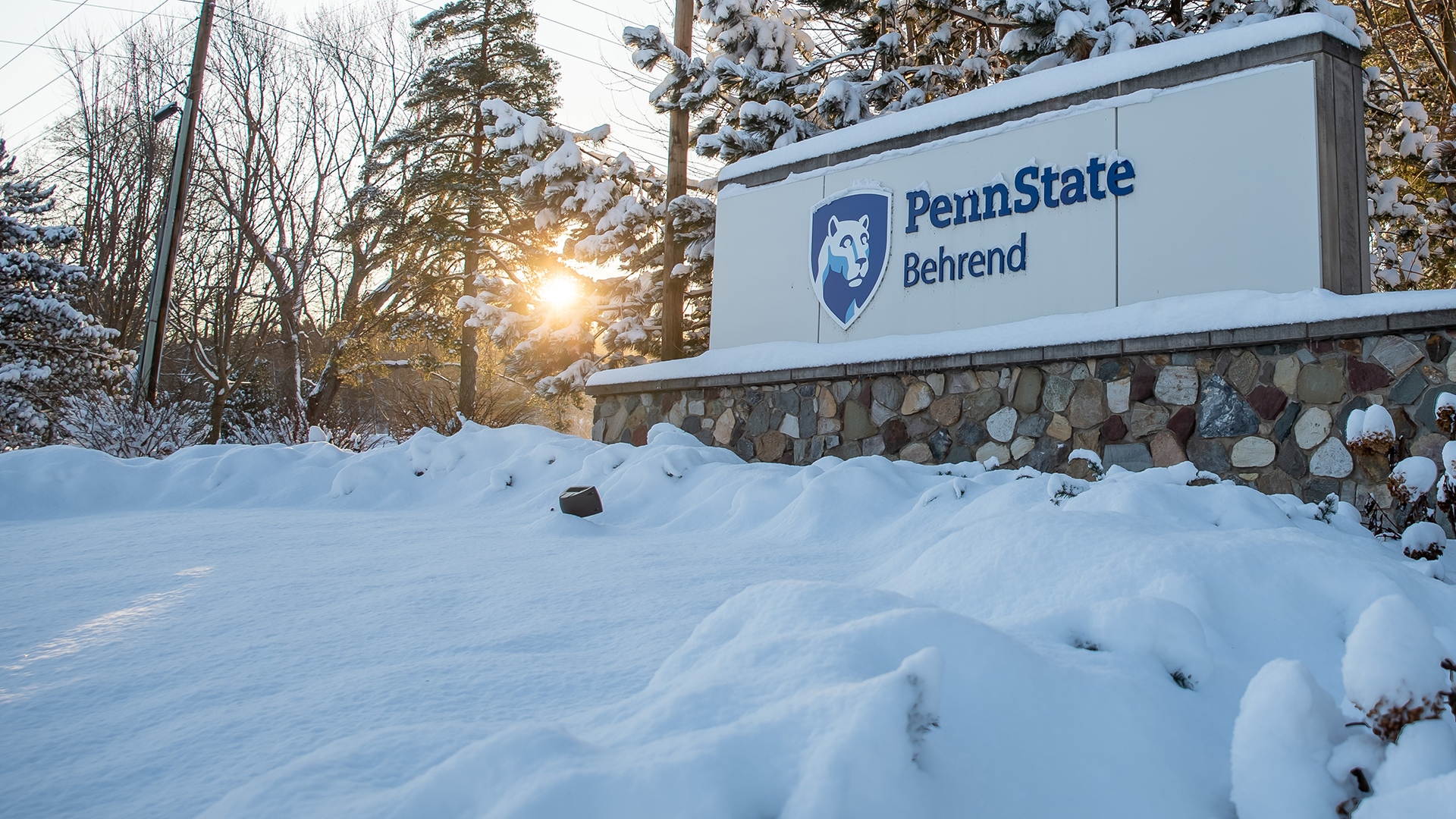 Penn State Behrend entrance sign in winter