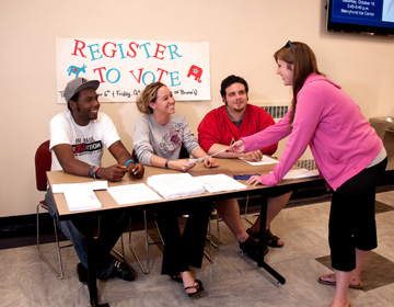 Students become involved in politics by encouraging voter registration.