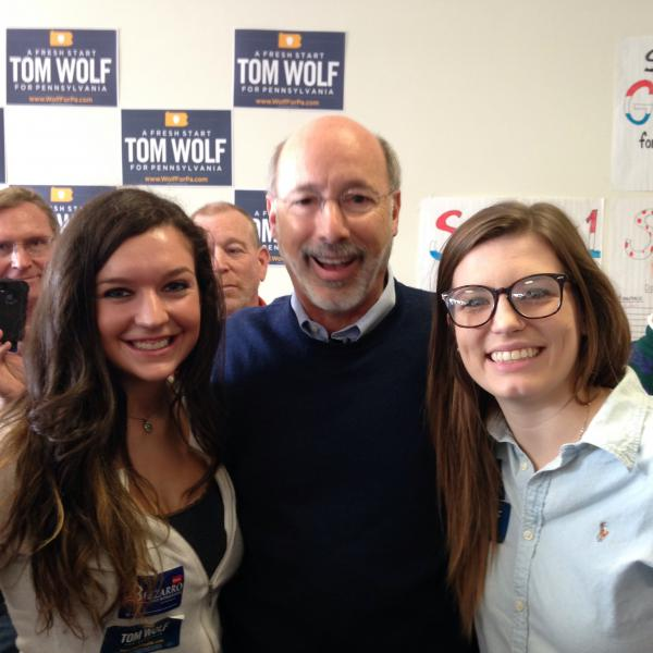 College Democrats Vice President Ashley Solo (left) and College Democrats President Lillie Gabreski (right) with Pennsylvania Governor Tom Wolf during a visit to Erie.