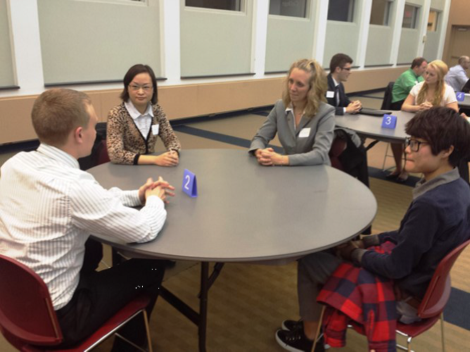 Students speaking with alumna, Amy Chapman