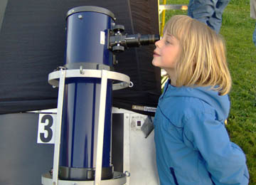 Girl with telescope at Open House in Astronomy