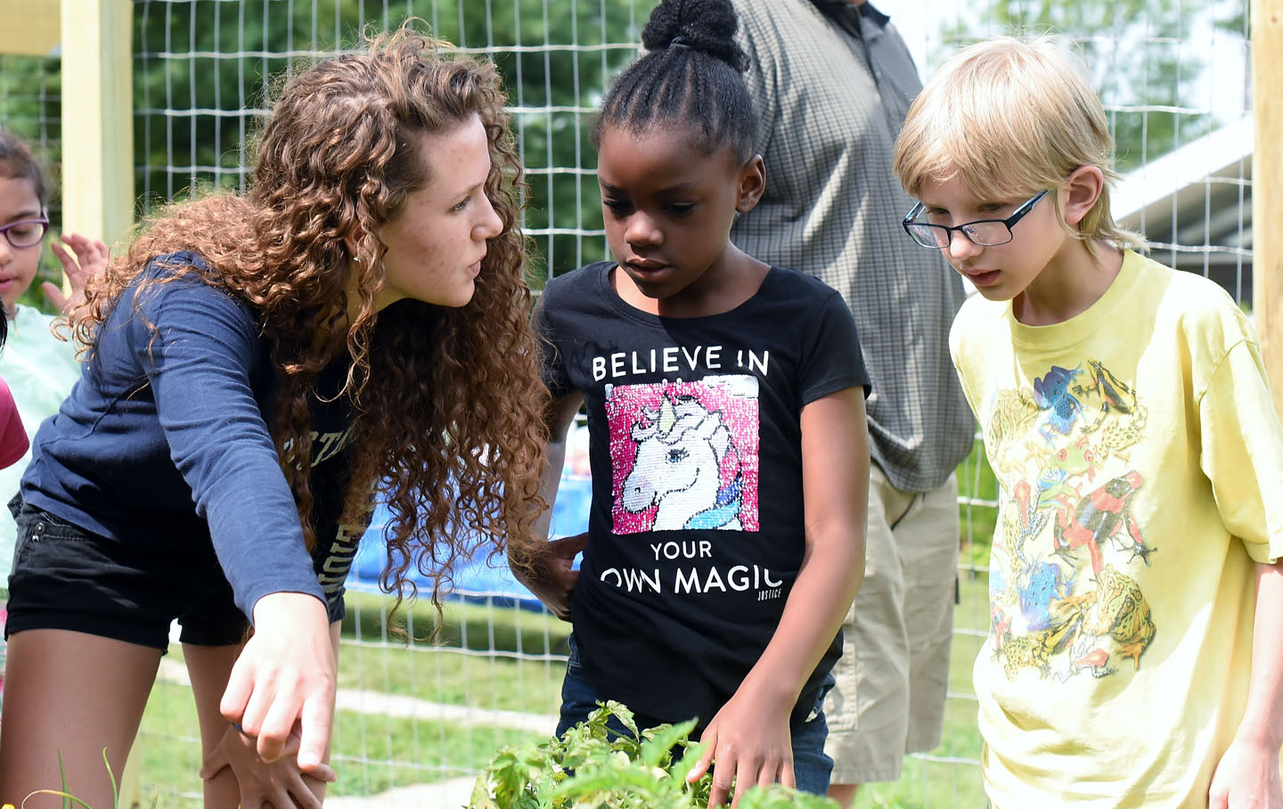 Penn State Behrend student works with students in campus garden