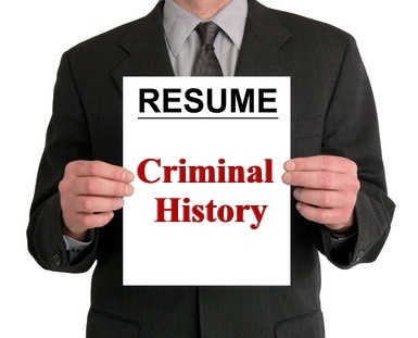 A person holding a resume that says Criminal History
