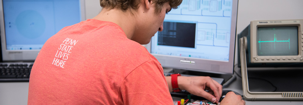 A student at Penn State Behrend works on a computer engineering project.