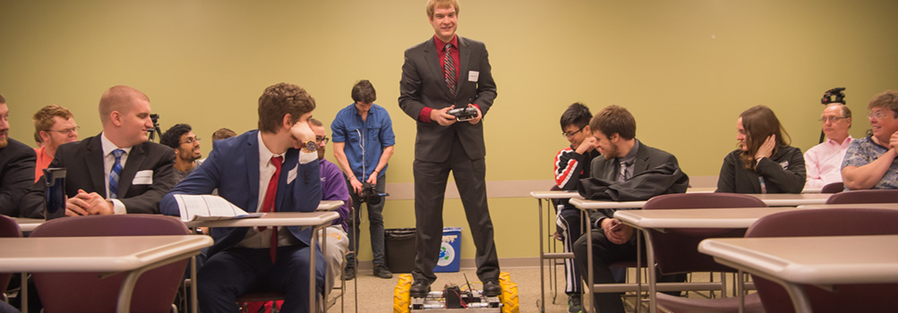 A student at Penn State Behrend demonstrates a hoverboard during a classroom presentation.
