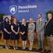 Six alumni members pose with Penn State Behrend Director of Athletics Brian Streeter.