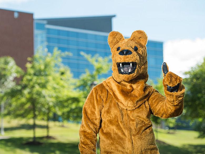Behrend Lion mascot in front of Burke Center