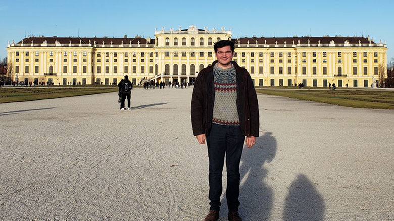 Alumnus Zane Dilts in front of a palace in Vienna