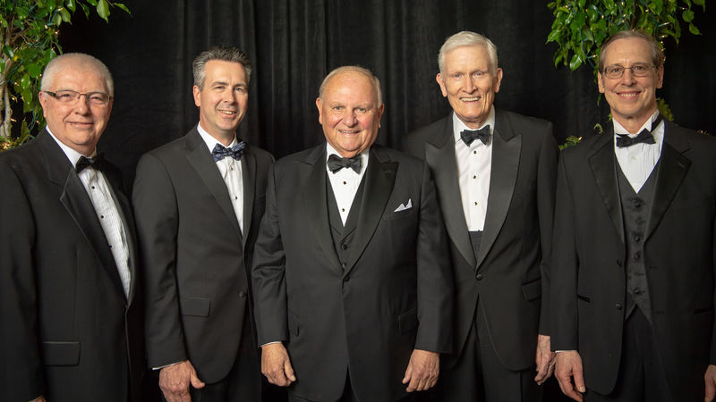 Four former and present Penn State Behrend leaders pose with Thomas B. Hagen