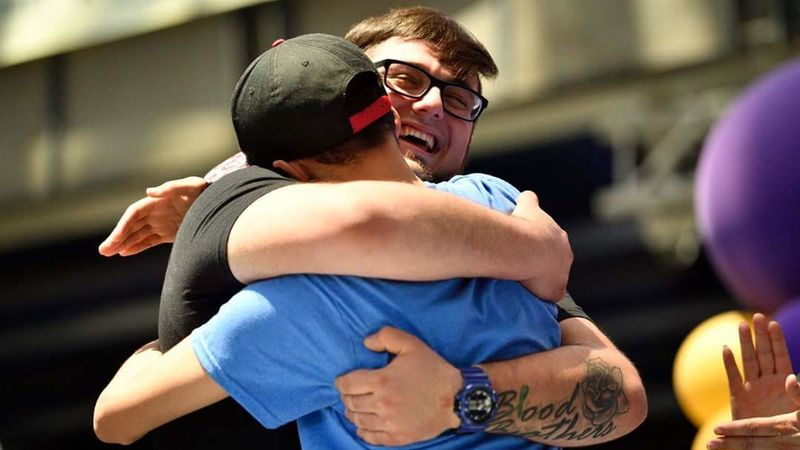 Penn State Behrend student Billy Santoro hugs a guy to whom he has donated bone marrow