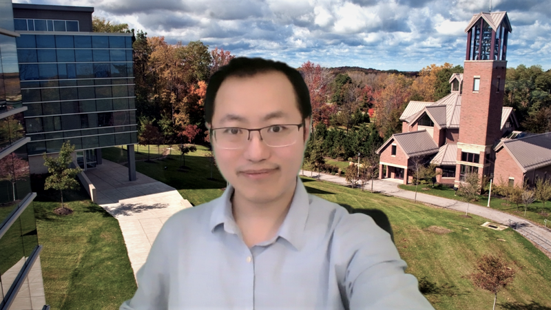 Richard Zhao, an assistant professor at Penn State Behrend, uses a custom backdrop of the Behrend campus during a class on Zoom.
