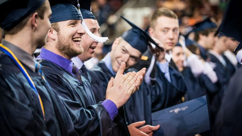 Students sit in rows at Penn State Behrend's spring commencement.