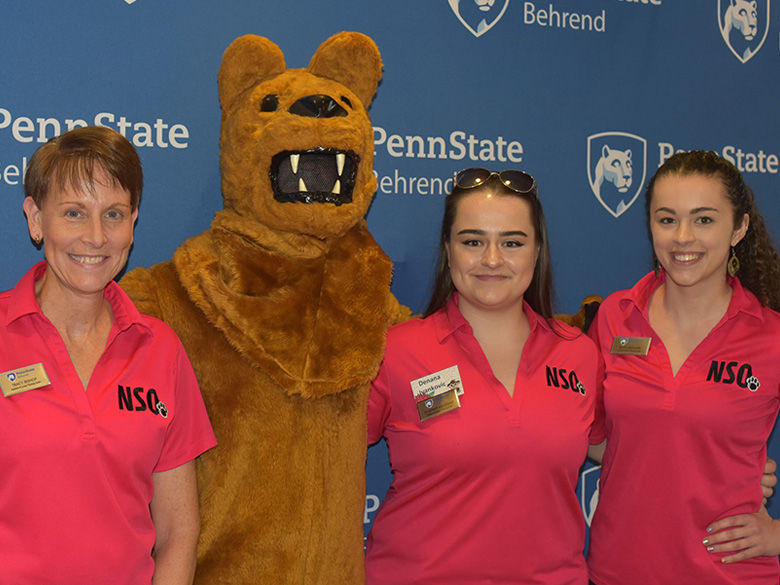 ACPC staff members hang out with the Behrend Lion at New Student Orientation (NSO).