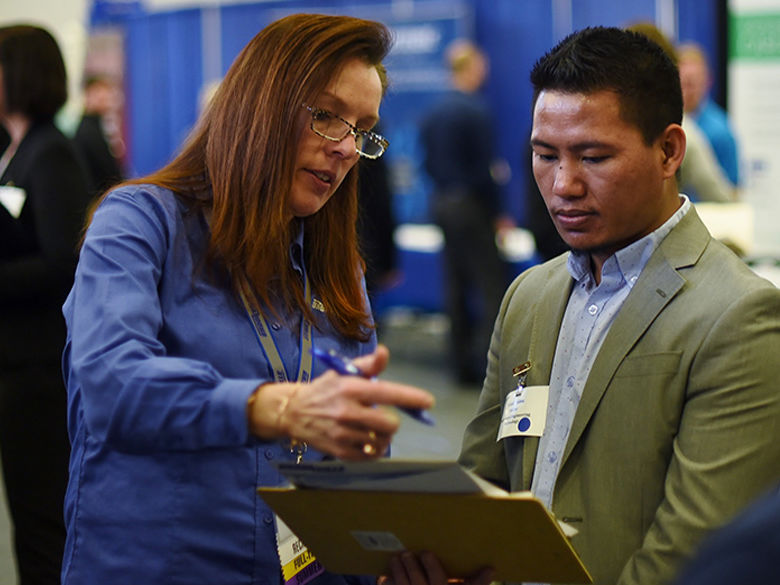 An employer meets with a student at a career fair at Penn State Behrend.