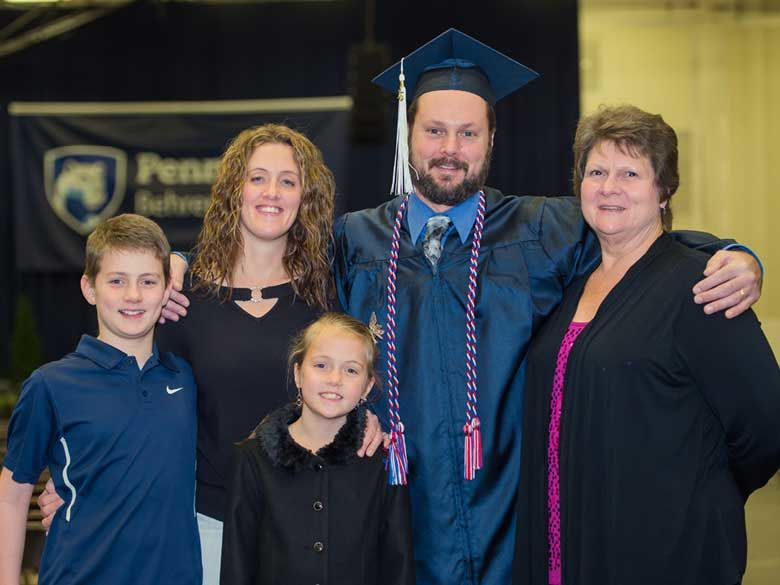 A Penn State Behrend Adult Learner celebrates commencement with his family.