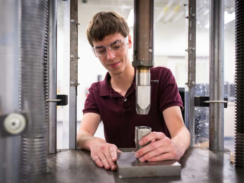 A Penn State Behrend student learns hands-on in an engineering lab.