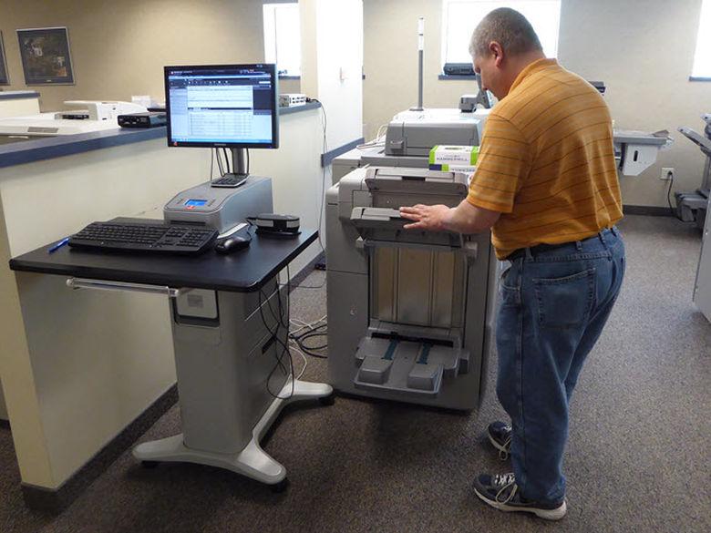 Copy Center staff making copies