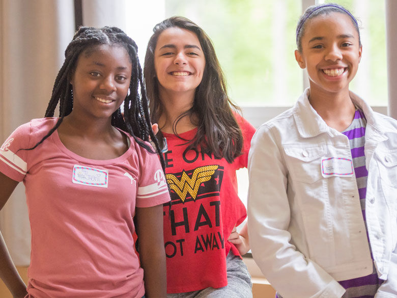 Three female students attend a CORE event.