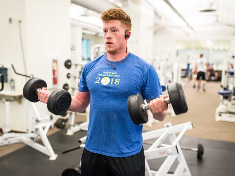 A male student works out at Penn State Behrend's Junker Center.