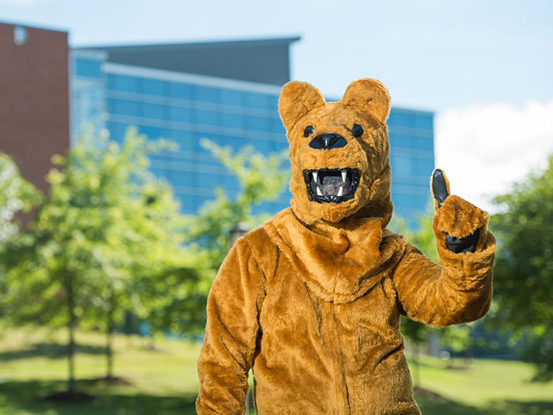 Nittany Lion mascot in front of Burke Center