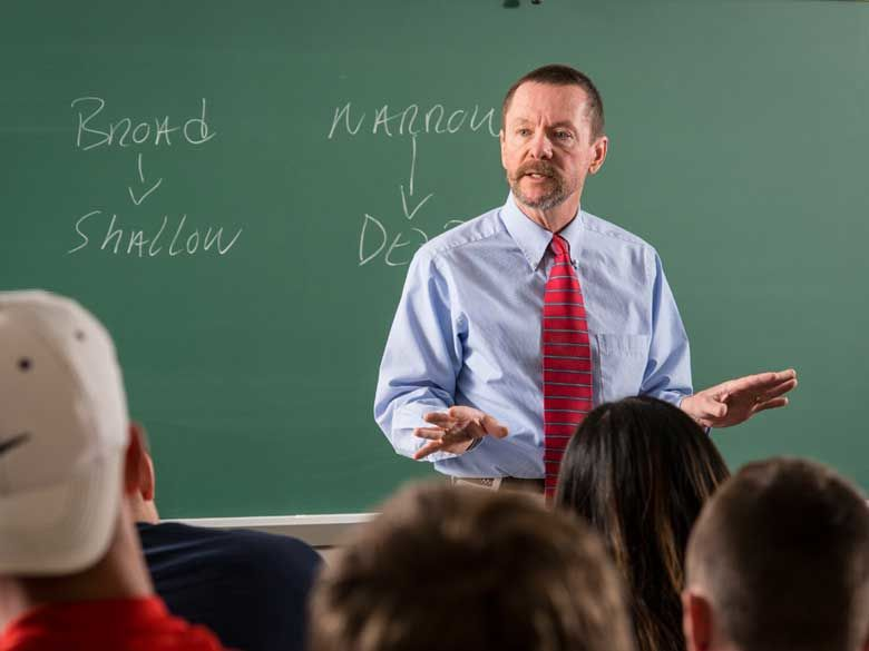 A Penn State Behrend faculty member leads a classroom discussion.