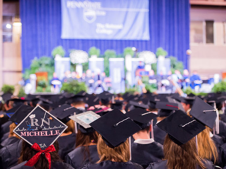 Two male graduates from Penn State Behrend