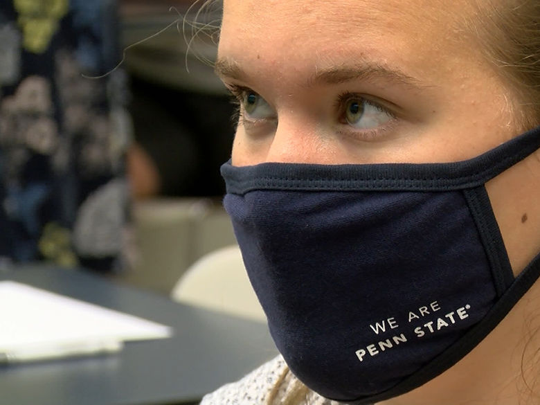 Female student wearing a fabric face mask