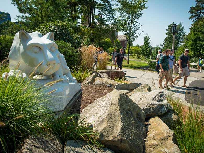 Penn State Behrend students walk by the Lion Shrine.