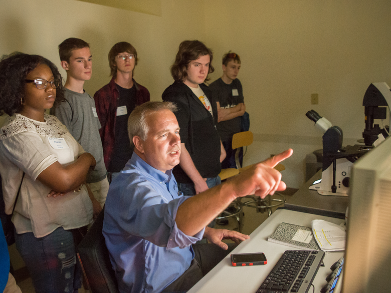 Students attend a computer demonstration.