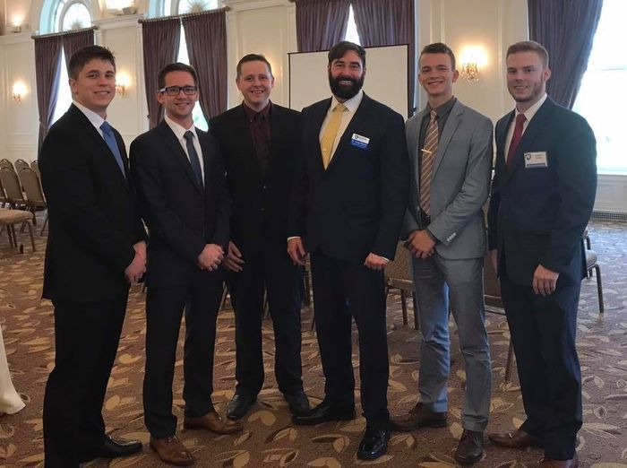 Finance Majors Participate in the CFA Society Pittsburgh Career Fair, From left, Matthew Colpoys, Andrew Hoverson, Nicholas Findley, Jason Pettner (president), Vilyamir Kolesnichenko, and Max Morrow.