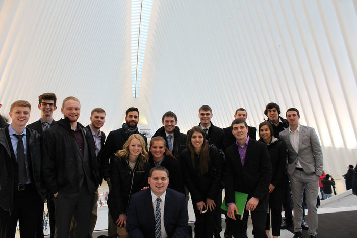School of Business Students gather in front of a shopping mall just outside of the 9/11 Memorial