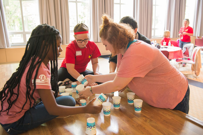 Students play a game with cups.