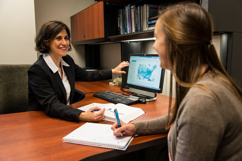 A professor works with a student in the Penn State Behrend MBA program.