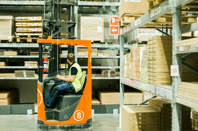A worker moves product in a warehouse distribution center.