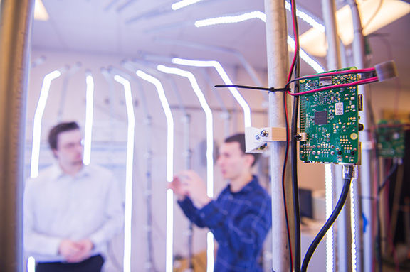 Two students demo 3D scanner that uses computer circuit boards