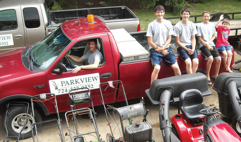 Bill Staniszewski, in the truck, and his brothers own and operate Parkview Lawn and Landscape in New Kensington.