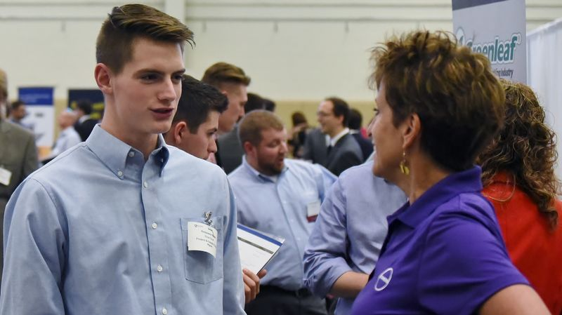 A student talks with a recruiter at the Penn State Berhend fall Career and Internship Fair.