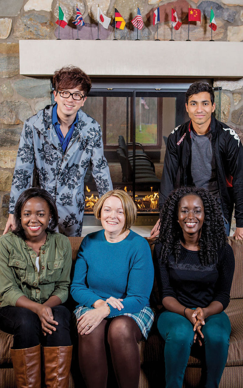 Dr. Mary-Ellen Madigan, senior director of enrollment management, center, with students. Sitting, from left, Mickie Macnicol and Khardiata Mbengue; standing, from left, Arthur Wang and Craig Miranda.