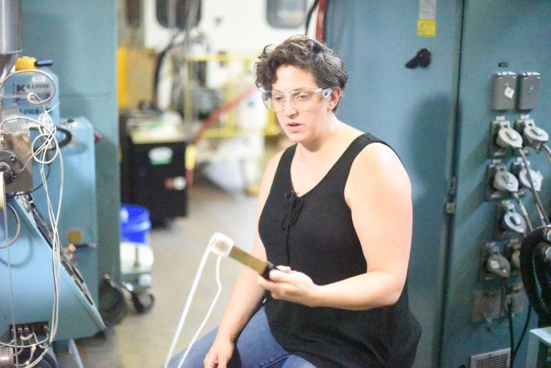 Cleveland Artist Lauren Herzak-Bauman works in the Penn State Behrend plastics lab.