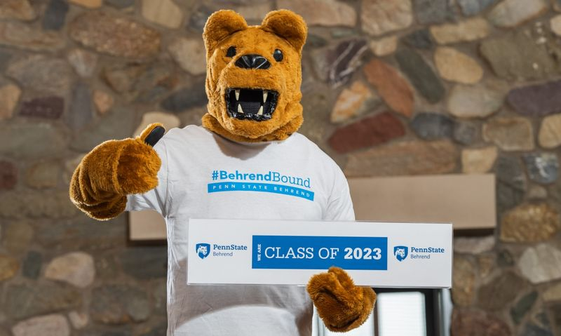 The Nittany Lion poses with a Class of 2023 sign