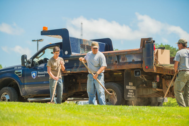 Penn State Behrend Maintenance and Operations staff work outdoors to keep the campus beautiful