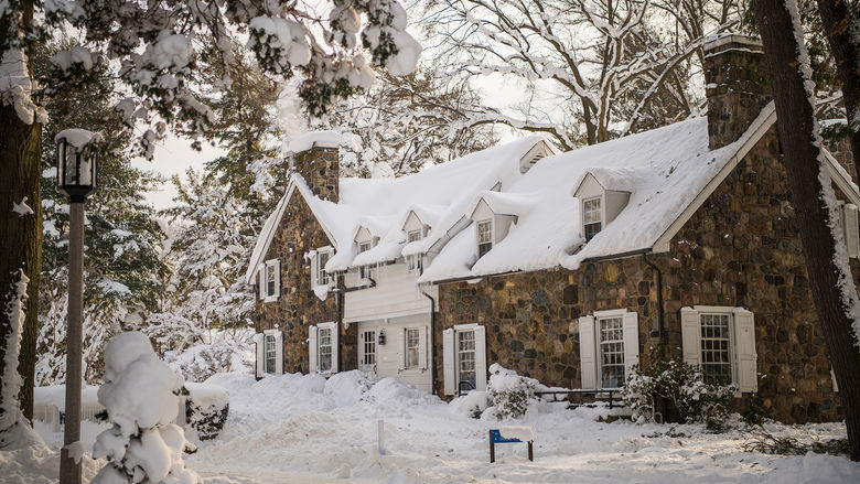 Snow covers the Glenhill Farmhouse at Penn State Behrend.