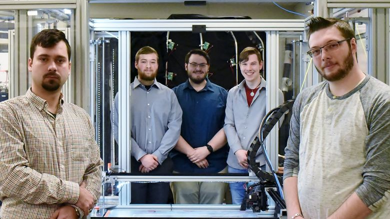 John Nowakowski, far left, Ryan Hutchinson, Michael Gibilterra, Elijah Thompson and Mike Paul worked together to build a large-format 3D printer from scratch in Penn State Behrend's Innovation Commons.