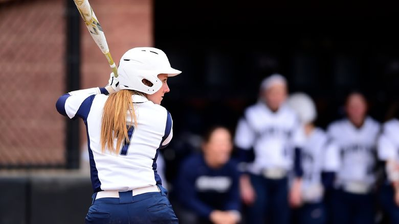 A Penn State Behrend softball player prepares to hit the ball.