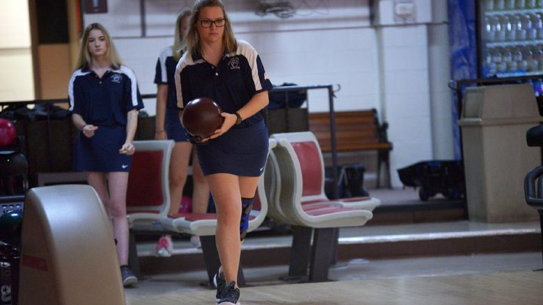 A Penn State Behrend bowler prepares to roll the ball.