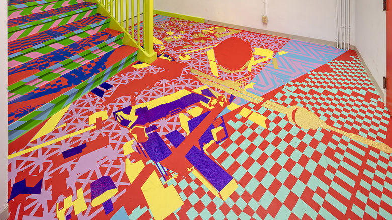 A brightly-colored art installation in a stairwell