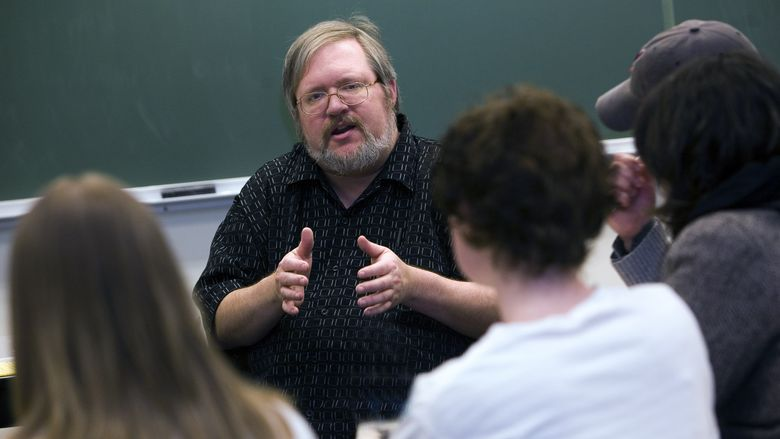 Penn State Behrend professor George Looney in a classroom with students