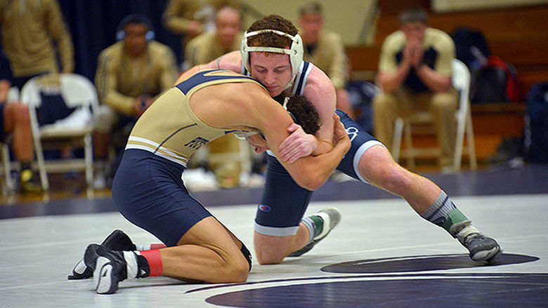 Penn State Behrend wrestler Michael Binni grapples with an opponent.