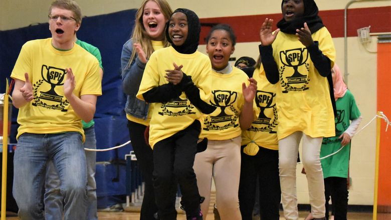 Pictured left to right, Matt Krause, Julie Lauris, Laila Abdirahman, Inihya Vaughn and Samira Babiker cheer on the unicorn ice cream truck during the 13th annual PLASTCar competition, held Dec. 11 at Penn State Behrend.